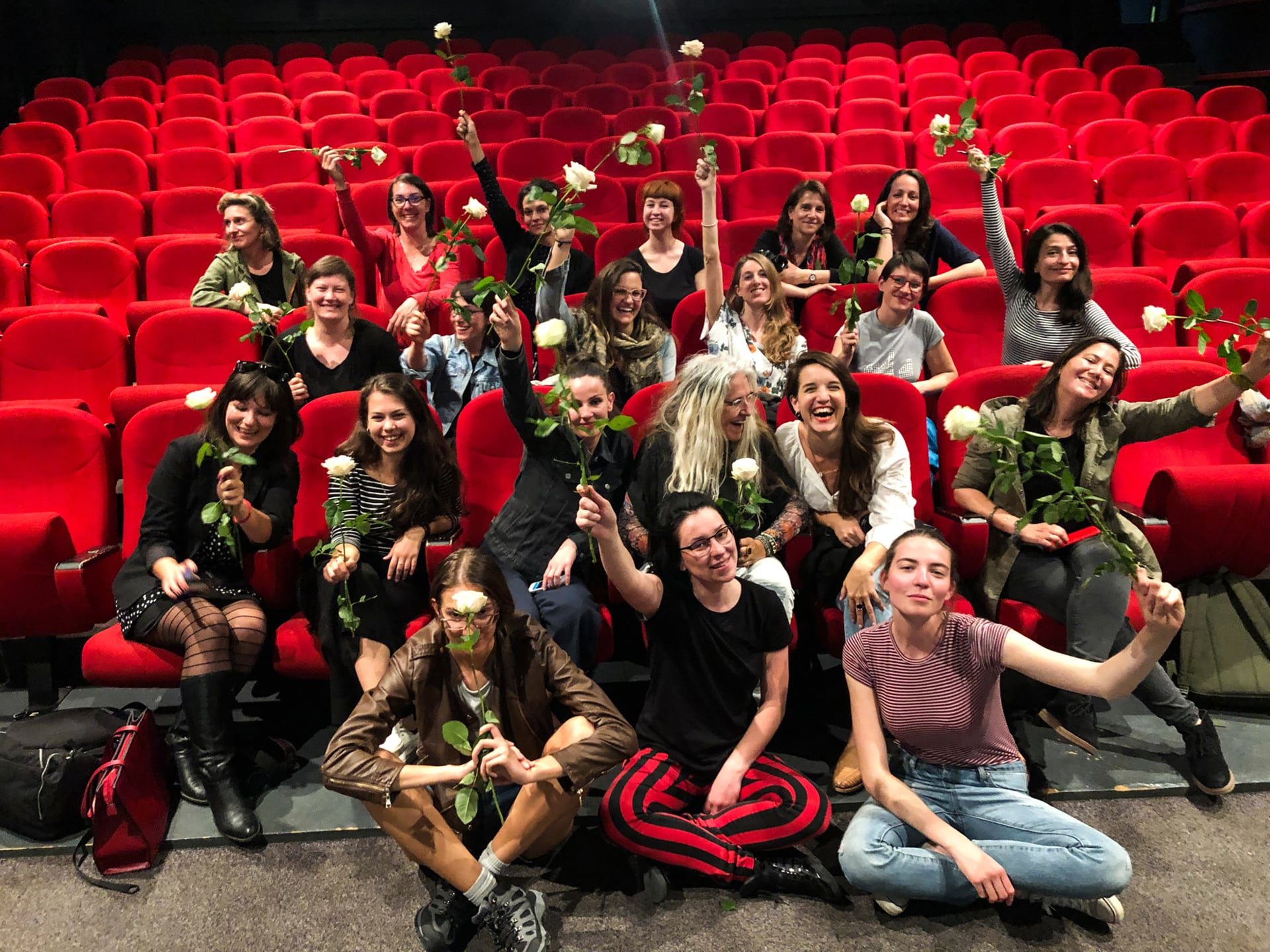 Students and instructors of the No Man's Land workshop pose for a photo with the roses they received upon completion of the workshop.