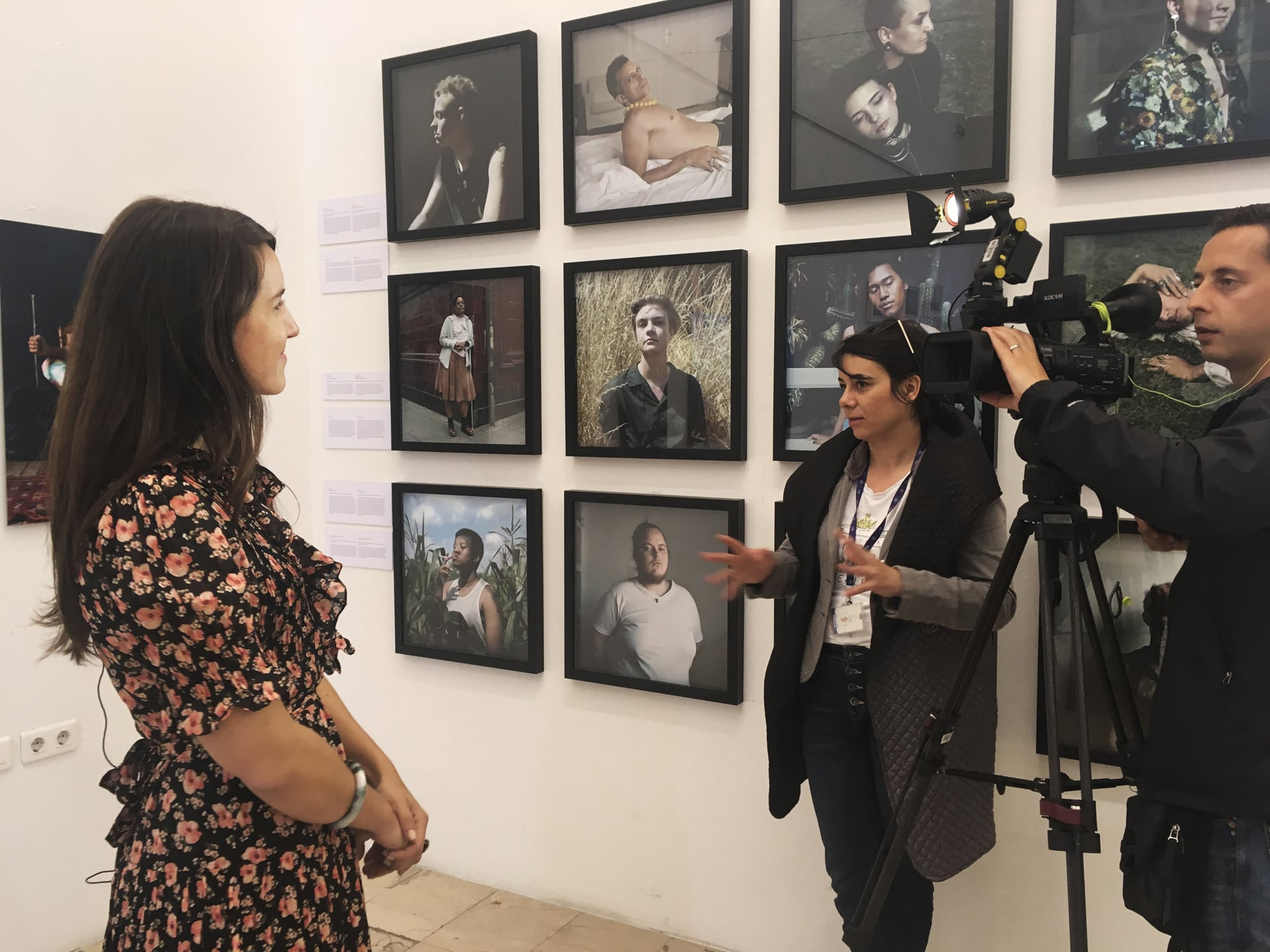 "Nichole Sobecki is interviewed by local news media before the opening of ""Her Take: (Re)thinking Masculinity."" ©Linda Bournane Engelberth / VII"