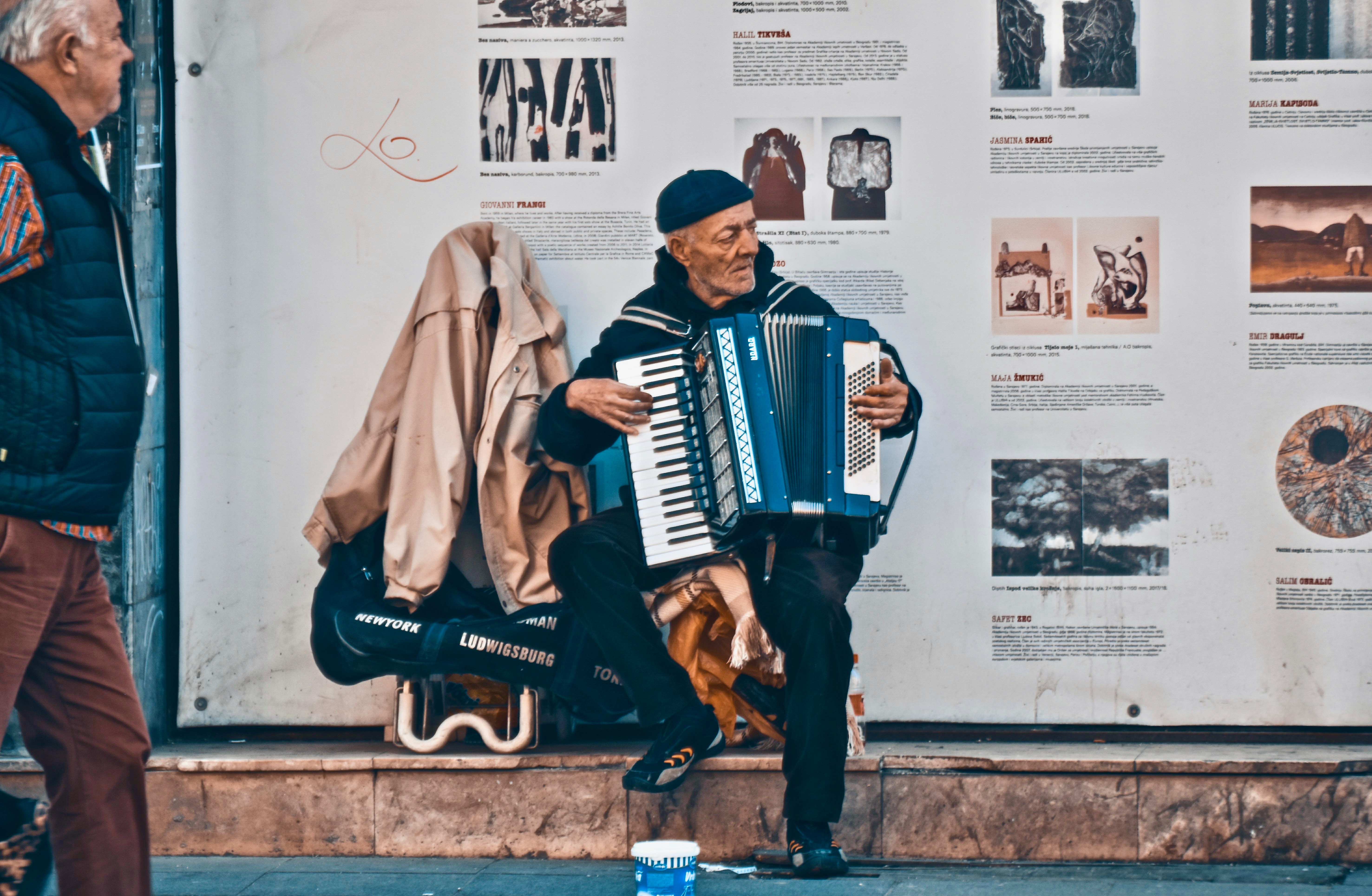 "Student work from the ""Something Sarajevo"" assignment: Local artists and street performers show off their talents to passers-by, adding to Sarajevo's charm and intrigue. This man plays his accordion, an instrument that is commonly found in one of Bosnia's most notable genres of folk music called Sevdalinka. Sevdalinka songs are often about love or unrequited love and are characterized by slow or moderate tempos with intense, emotional melodies. © Ibrahim Khaled Al-Zoubi"