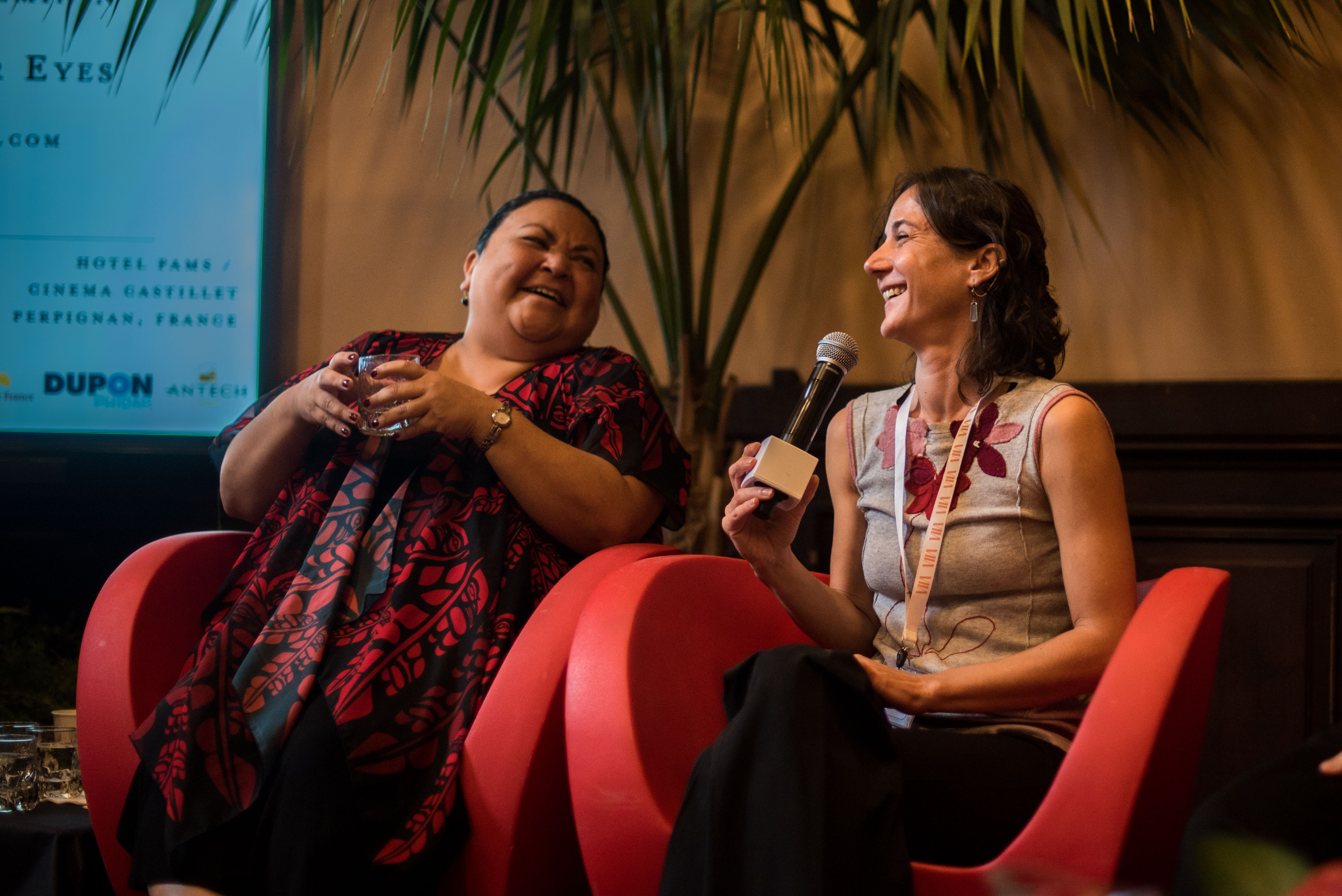 "Eden Robinson and Bénédicte Meillon laugh during the panel discussion ""Writing Nature: From a Female POV—How it could save the world"" on Sunday October 20, 2019 at the Nature: Through Her Eyes festival. © Stephane Ferrer Yulianti"
