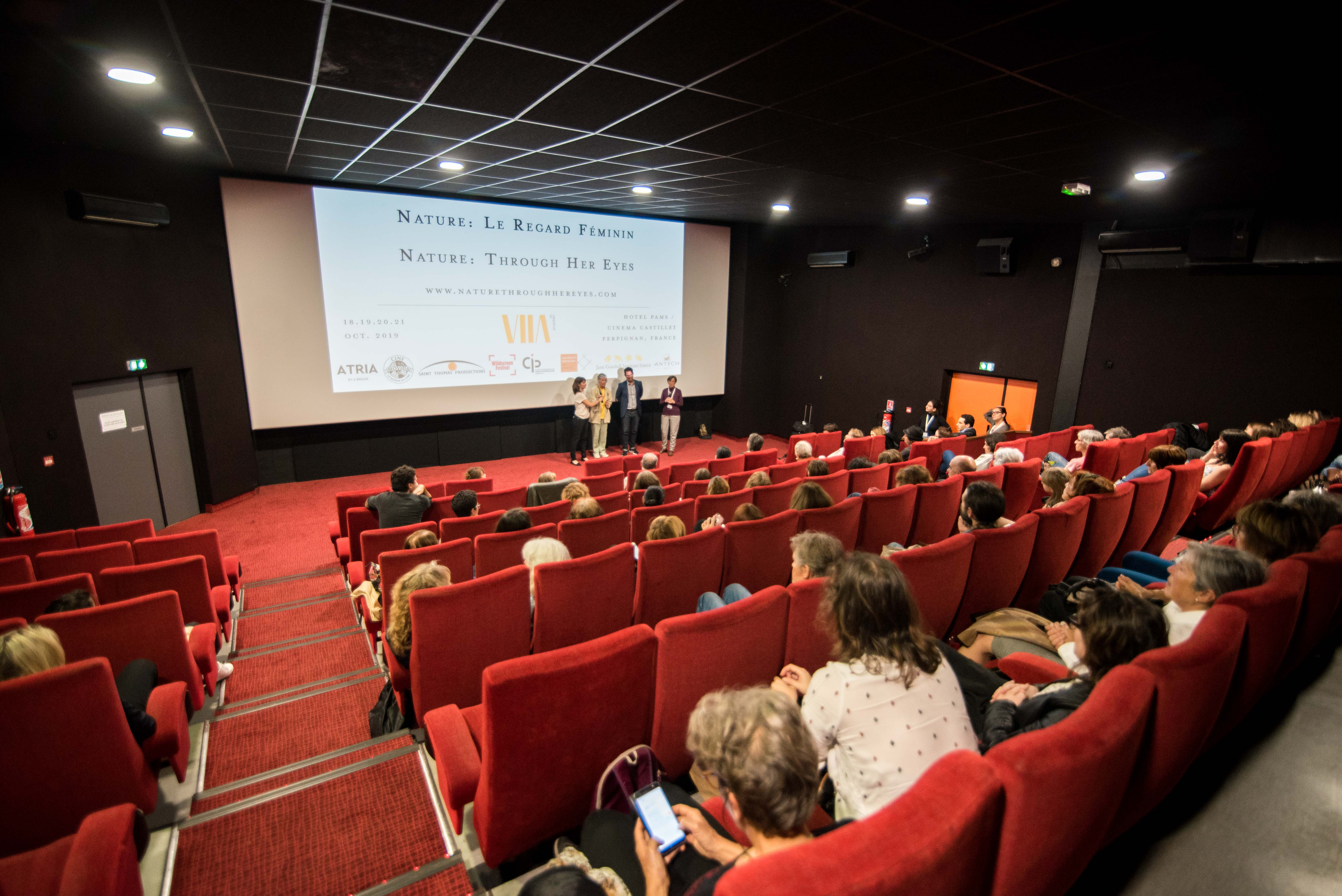 "The Nature: Through Her Eyes festival opened at the Cinema Castillet in Perpignan, France with a screening of ""The Woman Who Loves Giraffes."" Protagonist Anne Innis Dagg and Executive Producer Paul Zimic answer audience questions after the screening on Friday, October 19, 2019. © Stephane Ferrer Yulianti"